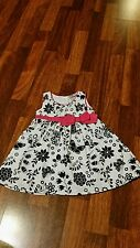Al & ray Baby girl Dress 12mo. White w/ Black pattern trimmed in pink!