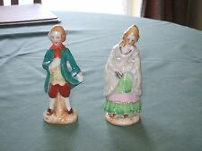 figurines of a man and a lady