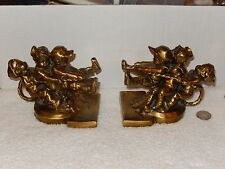 Vintage Pm Philadelphia Mfg  Children in play tug o' war bookends cast brass USA