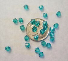 48 BLUE ZIRCON SWAROVSKI CRYSTAL  5301 BICONE BEADS 4MM