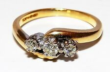A FINE  18CT YELLOW GOLD 0.15CT DIAMOND 3 STONE TWIST ENGAGEMENT RING