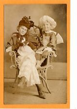 Studio Real Photo Postcard RPPC - Girl & Boy on Rattan Chair in Fancy Costume