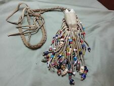 Vintage Bison Tooth necklace with buckskin pouch and Trade Beads