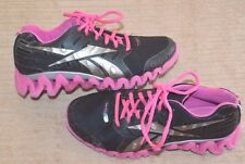 Girls size 4.5 Reebok Zig Tech athletic shoes Black and pink