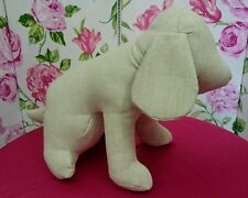 Dog Mannequin in sitting position made in upholstery fabric.  Made in England.