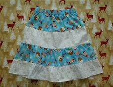 NEW GIRLS FUNKY CHRISTMAS FRILLY RUFFLE SKIRT. GINGERBREAD MEN & STARS. AGE 4-7.