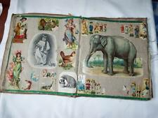 Antique scraps album in embroidered covers.