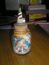 MONTEREY CALIFORNIA GLASS BOTTLE WITH SHELLS, SAND & LIGHTHOUSE TOP