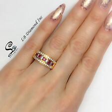 LADIES BAND 0.73 CT DIAMOND AND 0.75 CT RUBY RING IN 18 K YELLOW GOLD
