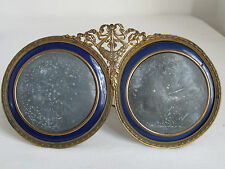 ANTIQUE FRENCH BRASS AND BLUE ENAMEL DOUBLE ROUND PICTURE FRAME
