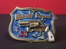 """Nobody Raped A .38"" Vintage 1982 Great American Belt Buckle"