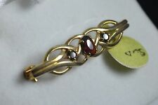 Brand new 9ct yellow gold fancy twist 3 stone ruby brooch pin