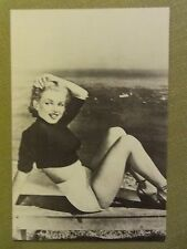 MARILYN MONROE 80s postcard 1951 in shorts and cropped top sitting by sea