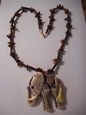 Tiger eye gemstone tube and chip bead necklace with Elephant pendant