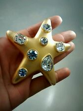 Runway statement  vintage Signed KJL Kenneth Jay Lane star rhinestone pin brooch
