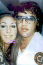 ELVIS PRESLEY WITH KARATE PATCH LINDA THOMPSON ON PLANE JUNE 1973 PHOTO CANDID