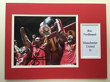"MANCHESTER UNITED RIO FERDINAND SIGNED 16""X12"" DOUBLE MOUNTED PICTURE DISPLAY"