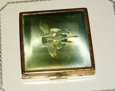Art Deco faux guilloche powder compact. Flying Geese. American. 1930/40.