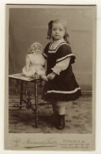 A BEAUTIFUL LITTLE GIRL WITH ATTITUDE POSES WITH HER BEAUTIFUL DOLL (GERMAN CDV)