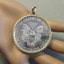 18ct gold New celtic pendant with one Oz fine silver eagle coin