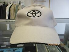 TOYOTA-NATURAL CAP W/ TOYOTA LOGO (ONLY) & EYELETS IN BLACK-METAL BUCKLE ADJ