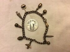 vintage Heavy Solid Brass 9 charm bracelet - includes airplane, light bulb , etc