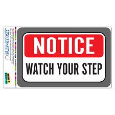 Notice Watch Your Step SLAP-STICKZ™ Premium Laminated Sticker Sign