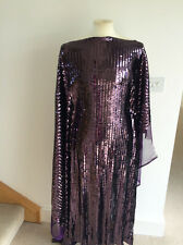Strictly Sequins! Aubergine Metallic Stretch Mesh Dressmaking Fabric  AW/2016