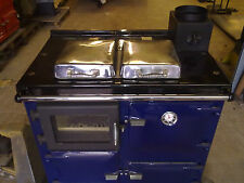 a wood -coal refurbished rayburn type range cooker with a glass door