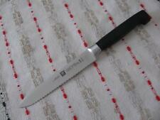 "ZWILLING J.A. HENCKELS FOUR STAR HIGH CARBON 5"" SERRATED KNIFE NEW, GERMANY"