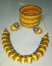 Yellow  silk thread jewellery set with antique bails.