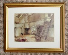 A BEAUTIFUL GOLD FRAMED CONTEMPORARY PRINT WOMAN WASHING IN OLD FARM BUILDING