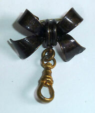 A VICTORIAN DARK BROWN ENAMEL BOW LOCKET / WATCH FOB BROOCH
