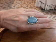BRAND NEW SILVER TONE RING WITH A LARGE PALE BLUE  STONE SIZE Q WITH GIFT BOX