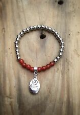 silver ball stretch bracelet with Follow Your Heat Charm And Carnelian Beads