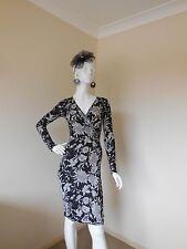 CLUB L  BLACK AND WHITE STRETCHY DRESS SIZE 8  TO 10