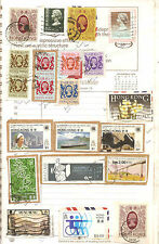 Hongkong stamps mounted on envelope then on old scrap book page !