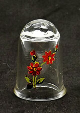 Clear glass thimble with a delicate red daisy flower design