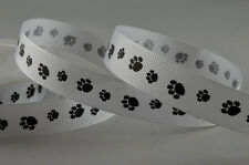 2 Metre cut length of 16mm wide white grosgrain ribbon with black dog paw prints