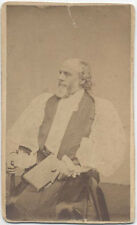 CDV, BISHOP SITTING IN CHAIR HOLDING BOOK. SYRACUSE, NY.