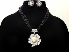 SWAROVSKI CRYSTAL BLACK AND SILVER FLORAL MOTHER PEARL ON BLACK BEADED NECKLACE.