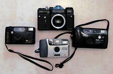 4 film cameras: ZENIT EM, Konica AF-800, Pentax PC-550, Polaroid 35mm