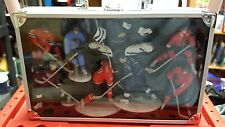 1990S NHL SET OF 8 HOCKEY PLAYER FIGURES IN A ALLUMINUM CASE , NEW IN BOX.