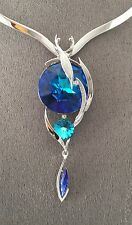 "SWAROVSKI ""HELIOTROPE"" TRIPLE CRYSTAL ELEMENTS PENDANT AND SCOOP V NECKLACE"