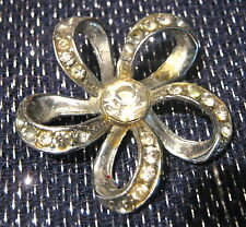 Classic Vintage Silver tone brooch in a flower form with white stones