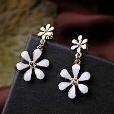 Very pretty gold tone white enamel daisy chandelier earrings