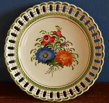A hand painted European folk art signed art ribbon plate