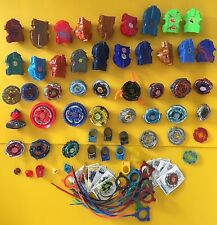 Mixed Lot of Beyblades, Parts, and Accessories