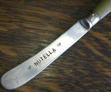 hand stamped NUTELLA  tea knife amber  handle
