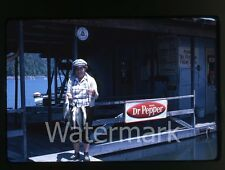 1960s kodachrome  Photo slide Lady with caught fish fishing dock Dr Pepper slide